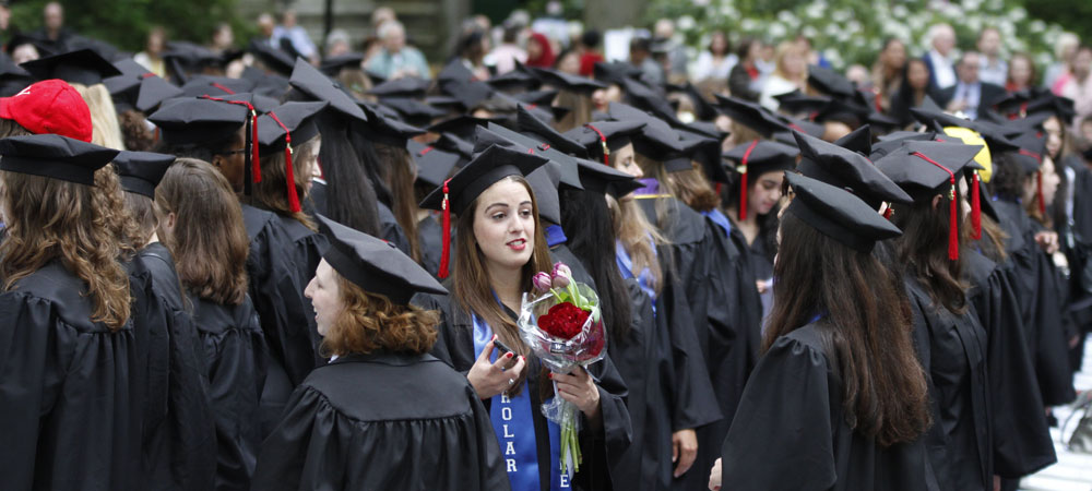 Class of 2012 Student Holds Bouquet of Red Roses at Commencement