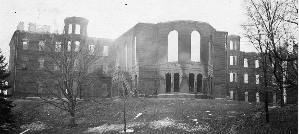 A missing roof and entrance of College Hall after the fire