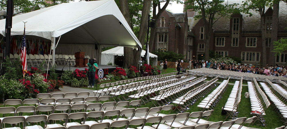 A sea of white chairs and red decorations spread out across the field, ready for the class of 2012