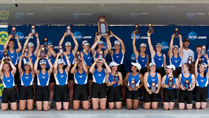 Wellesley crew grouped for photo shows of trophies