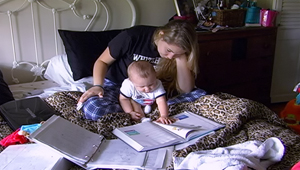 scene from show with teen doing homework with baby