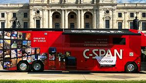 red c-span bus