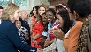 Hillary Clinton greets emerging women leaders from around the world