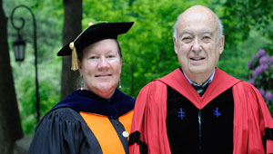 Kristin Butcher and Marshall Goldman stand together in academic regalia