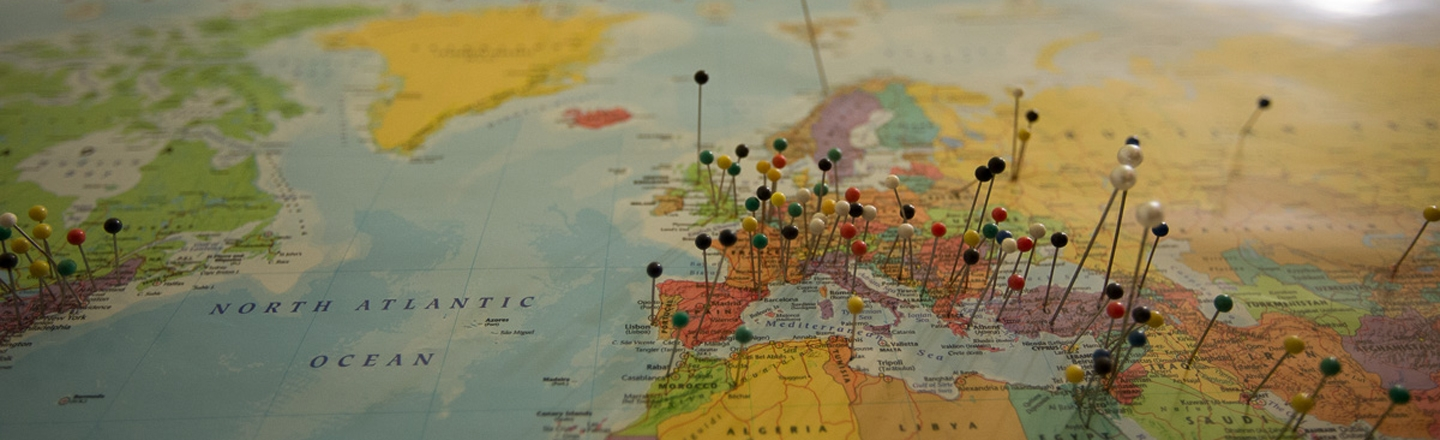 world map with pins in it