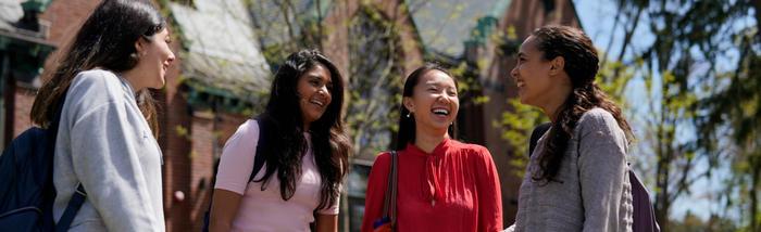 Four Wellesley students walking outside