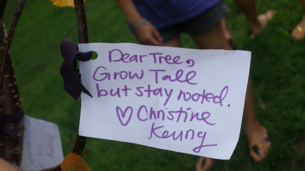 A student's message reads: Dear Tree, Grow tall, but stay rooted. Love, Christine Keung