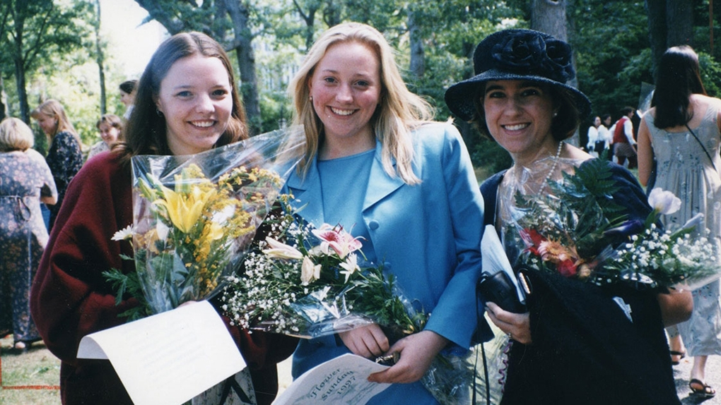 students with their flowers on Flower Sunday