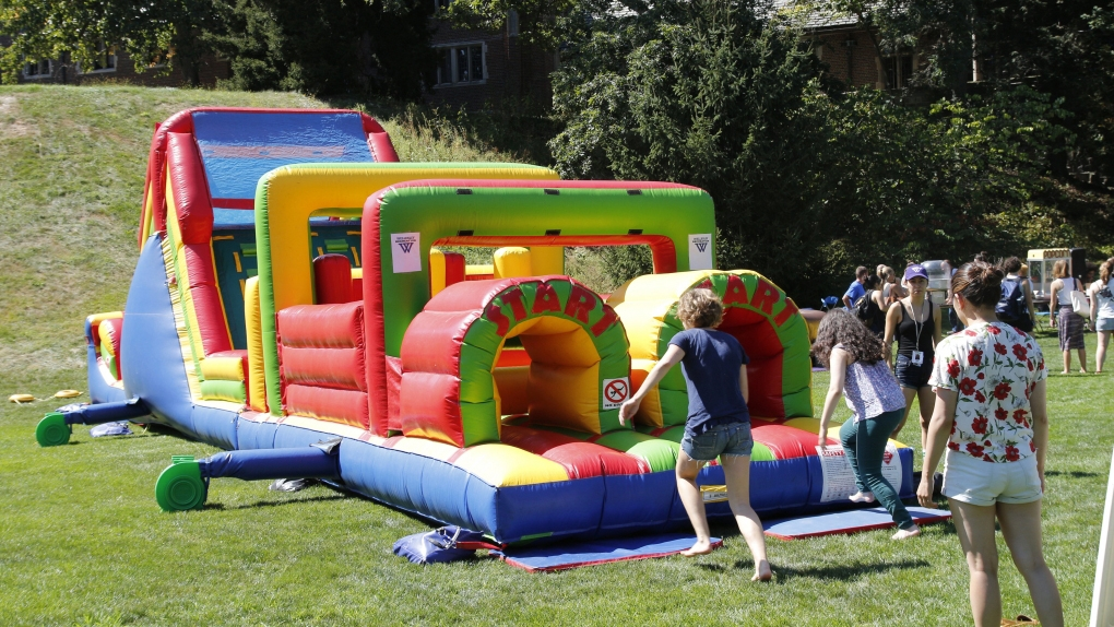 students race on the bouncy obstacle course during lake day