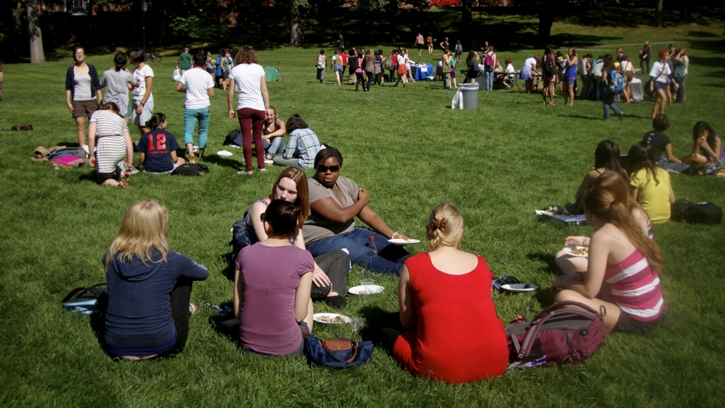 students eat on the lawn