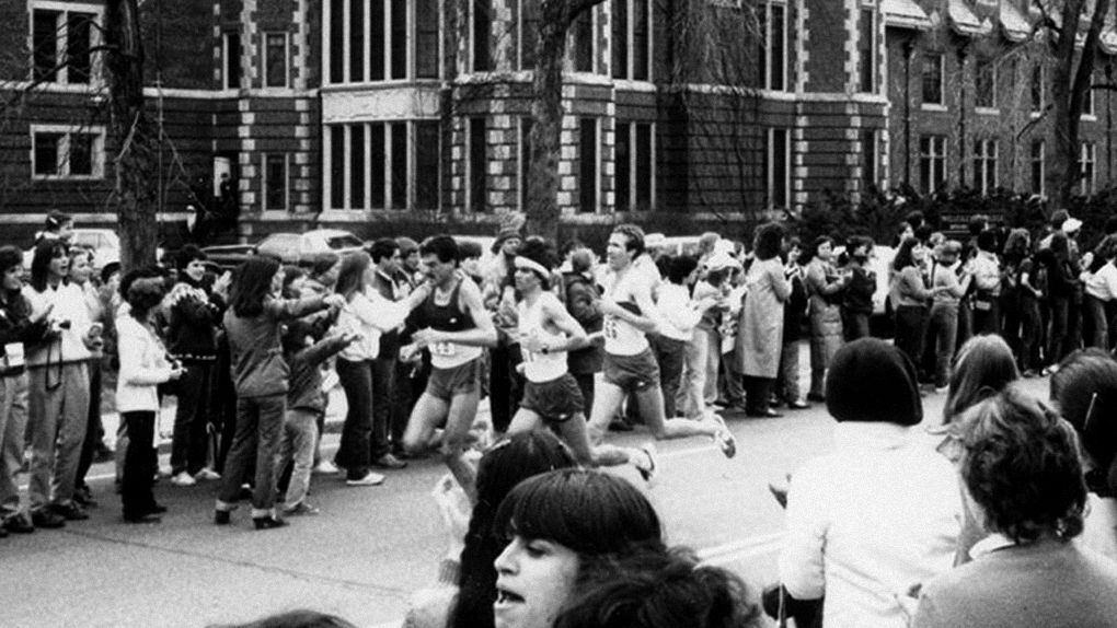 students cheer on a runner in a vintage Scream Tunnel shot