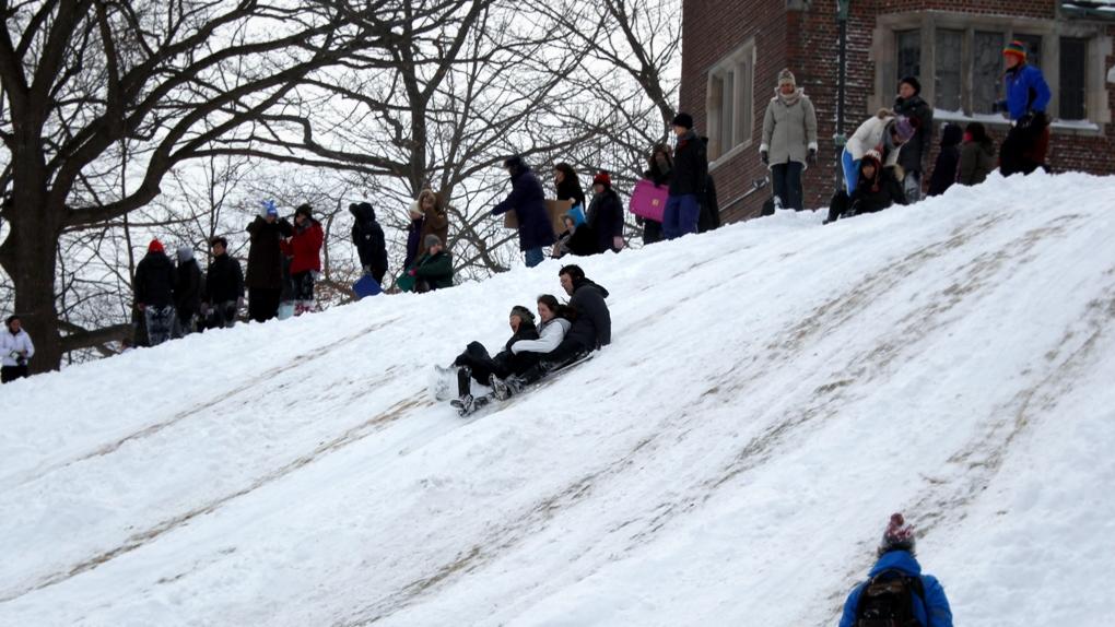 Students sledding on Sev Green