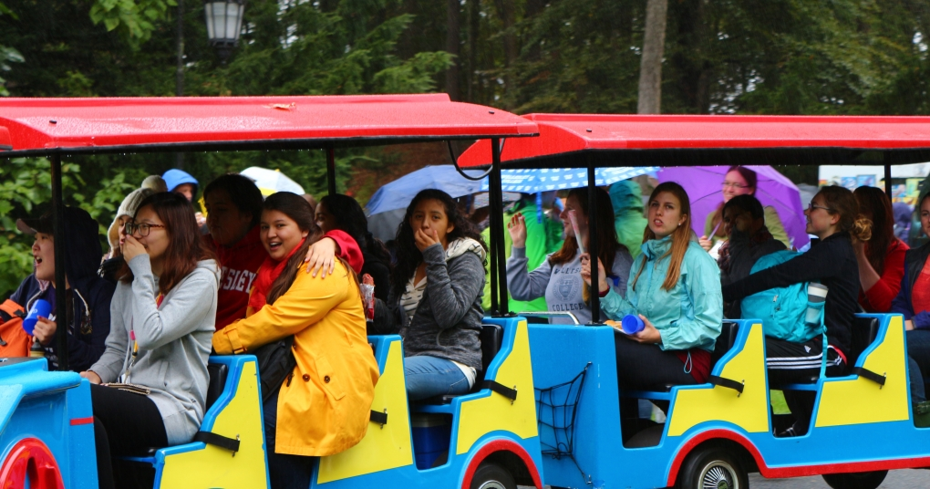 Students ride a mini-train