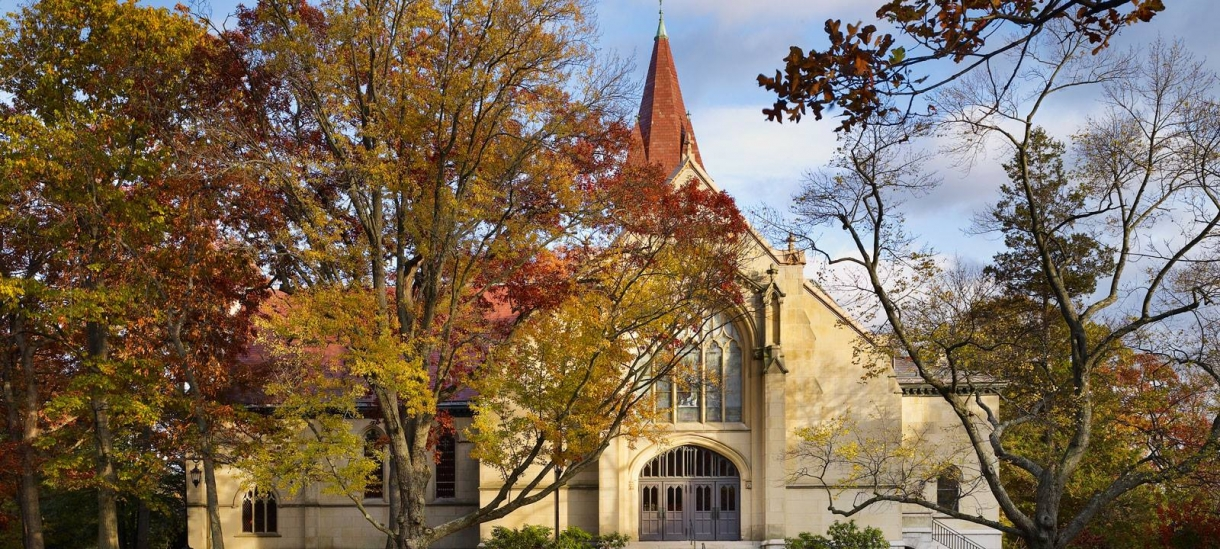 The houghton Chapel at Wellesley College in autumn