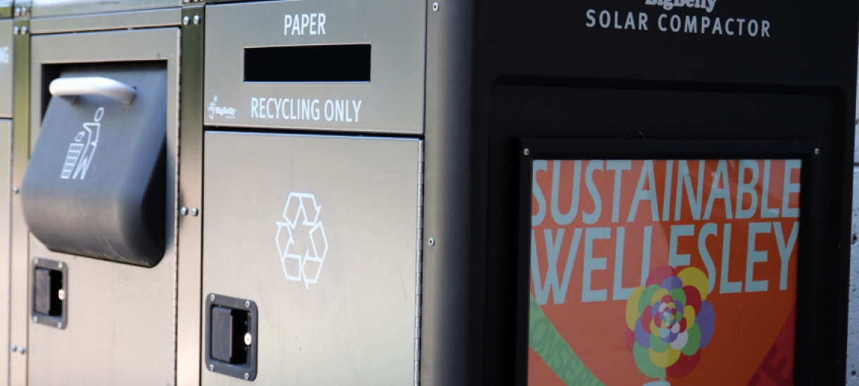 Solar compactor with Sustainable Wellesley written on the side