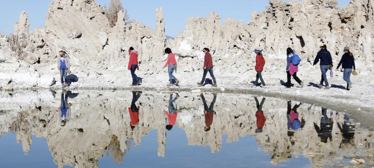 students walking around a lake