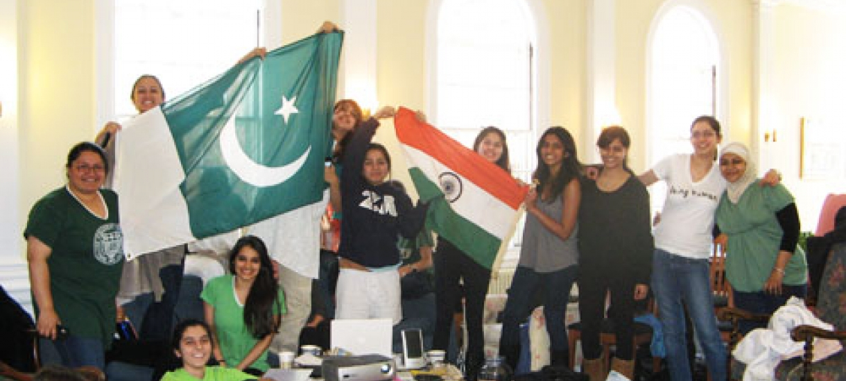 Students from India and Pakistan holding flags