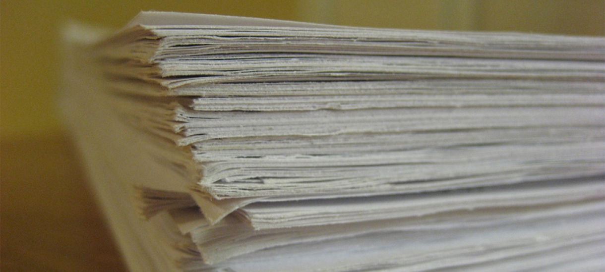 papers stacked on a desk