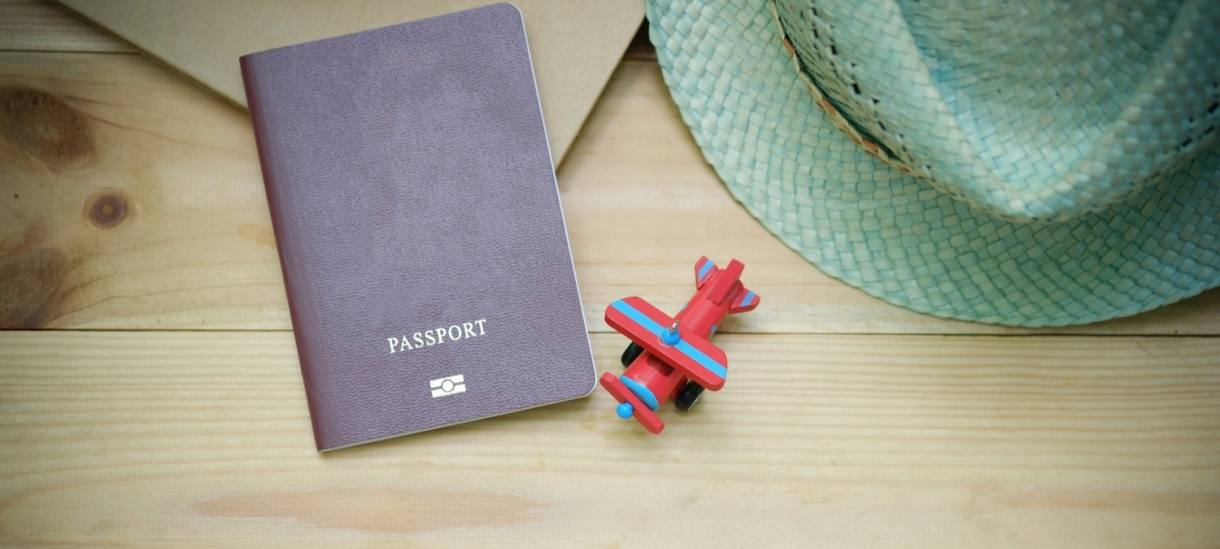 Passport and toy airplane