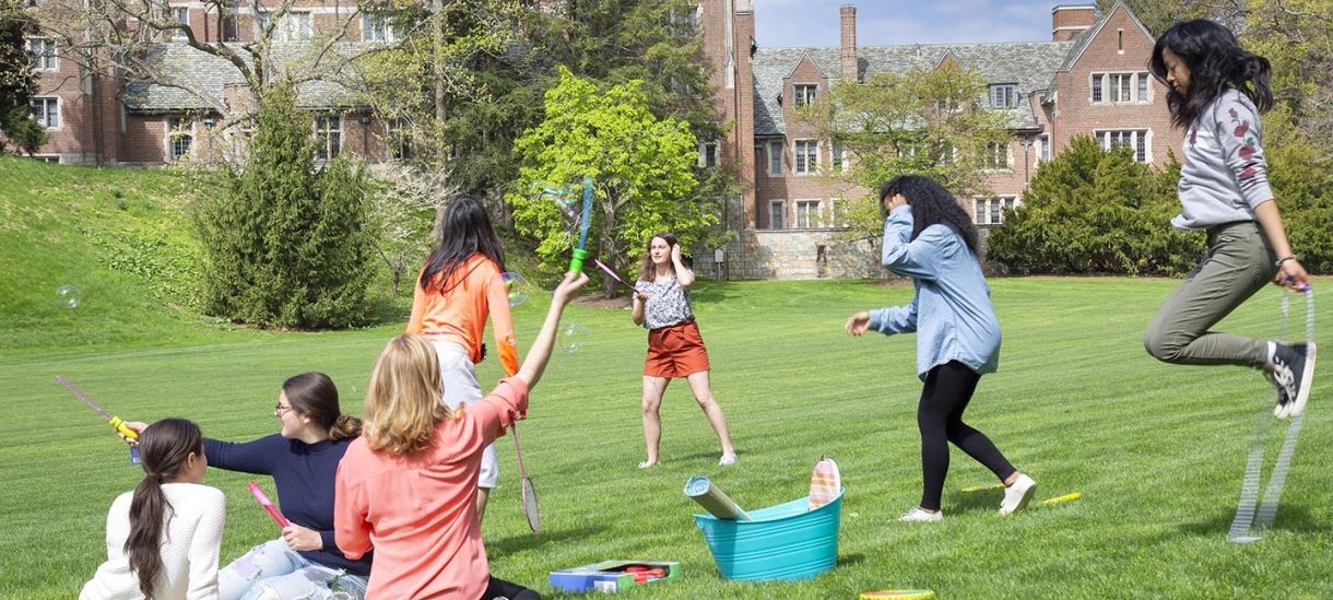 students enjoying wellness activities on the lawn