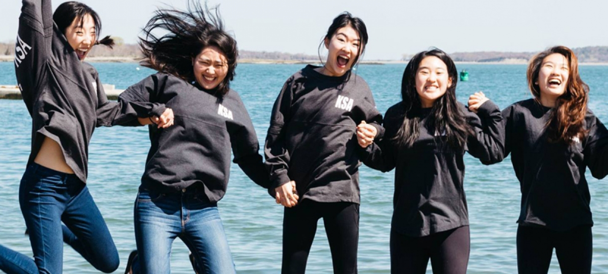 Members of the Korean Student's Association frolic in front of the lake