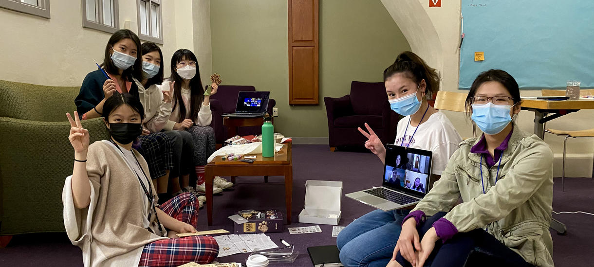 Students in dorm having program with masks on