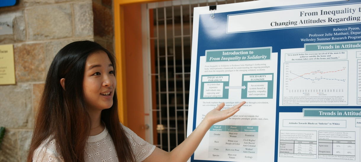 Student gives presentation on summer research