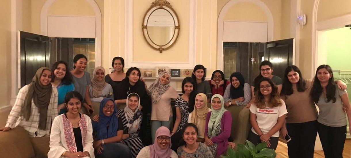 The Muslim Chaplaincy student group, Al-Muslimat gathers for a group photo.