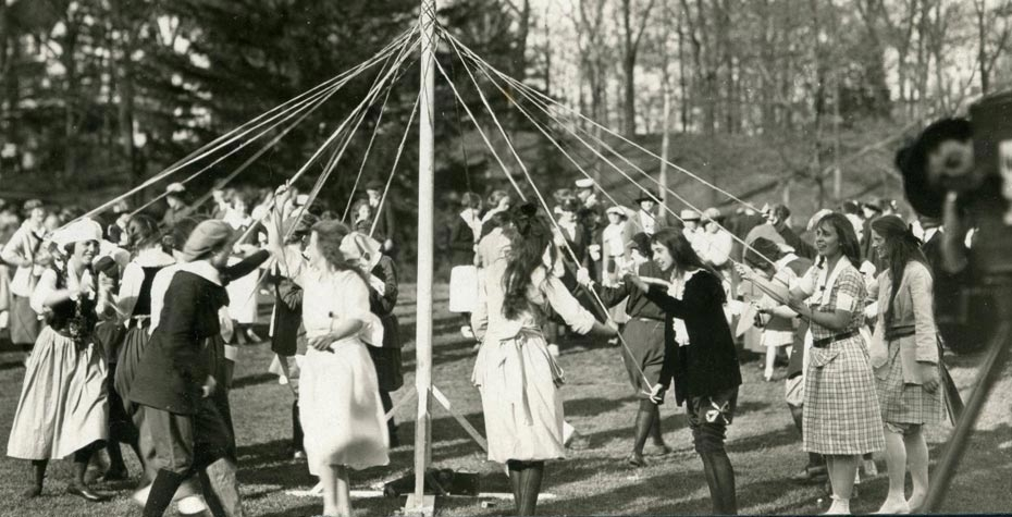 closeup of students dancing around maypole, 1919