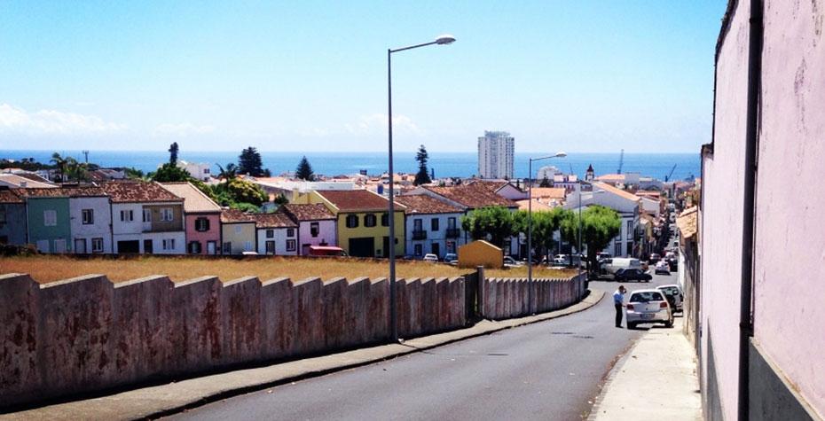 street scene with ocean in distance