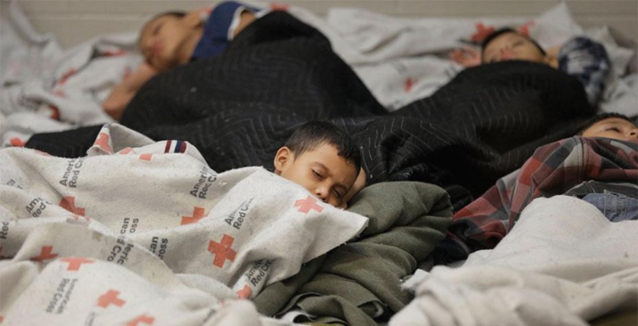 children sleeping in refugee center