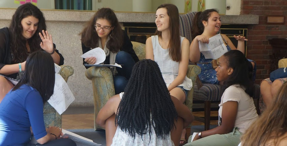 diverse students discuss leadership styles in small group