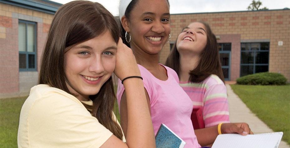 three tweens outside school