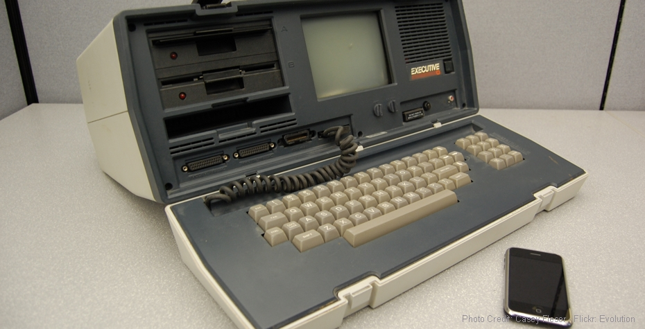 A portable computer from 1982 next to a 2007 Apple iPhone. (Credit: Flickr, Casey Fleser)