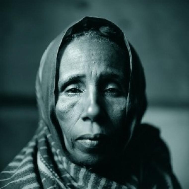 Fazal Sheikh, Saladho Hassan Ali, whose daughter, marakaba, faught off an attacker near hagadera camp in early 2000 (detail), 2000. Toned gelatin silver print. © Fazal Sheikh