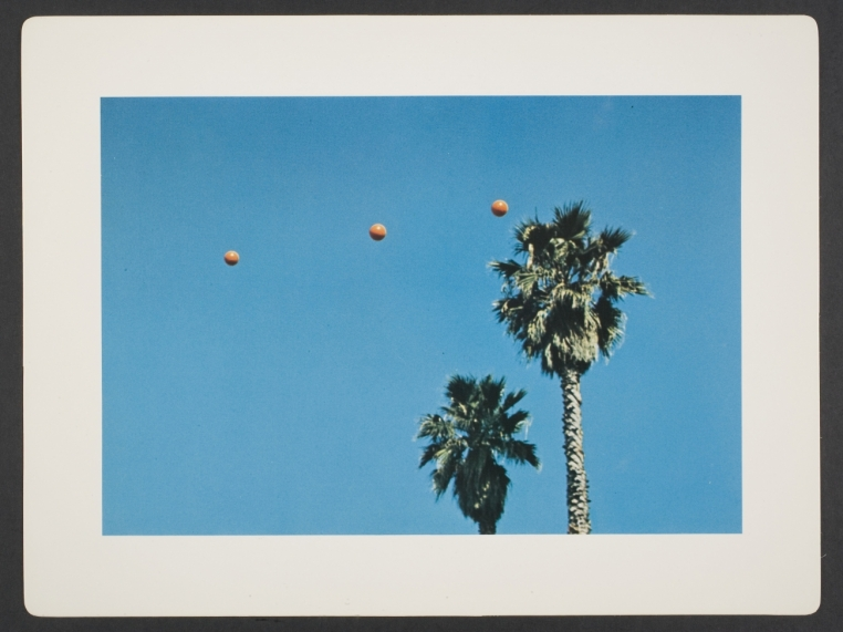 John Baldessari, Throwing Three Balls in the Air to Get a Straight Line (Best of Thirty-Six  Attempts), sheet from artist book consisting of folio cover and fourteen leaves, 1973. 9 5/8 in. x   12 3/4 in. (24.4 cm x 32.4 cm). Museum purchase, The Nancy Gray Sherrill, Class of 1954,   Acquisition Fund. 2007.161 © John Baldessari