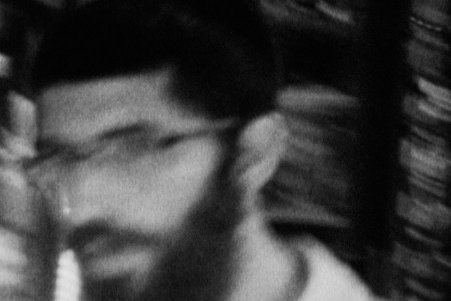blurred black and white image of a man's face, movie still from 400 shots