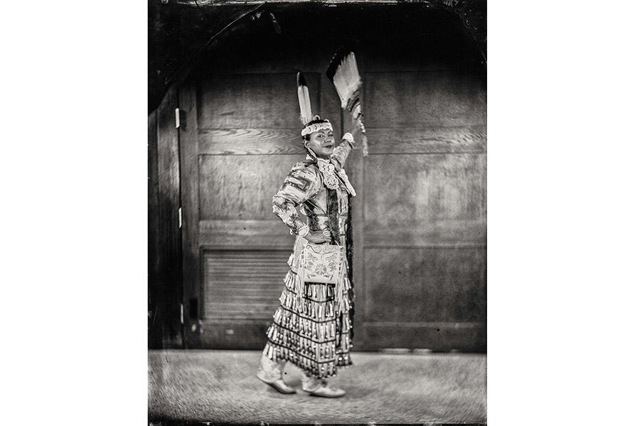 black and white photo of a Native American woman posing