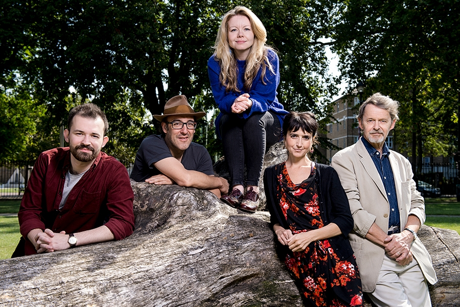 members of Actors From The London Stage posing on a tree trunk