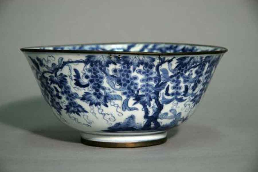 image of a porcelain bowl with blue illustration on it
