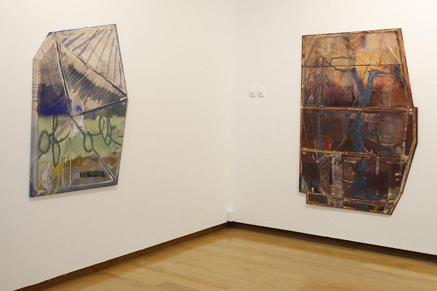 image of paintings hung in a gallery
