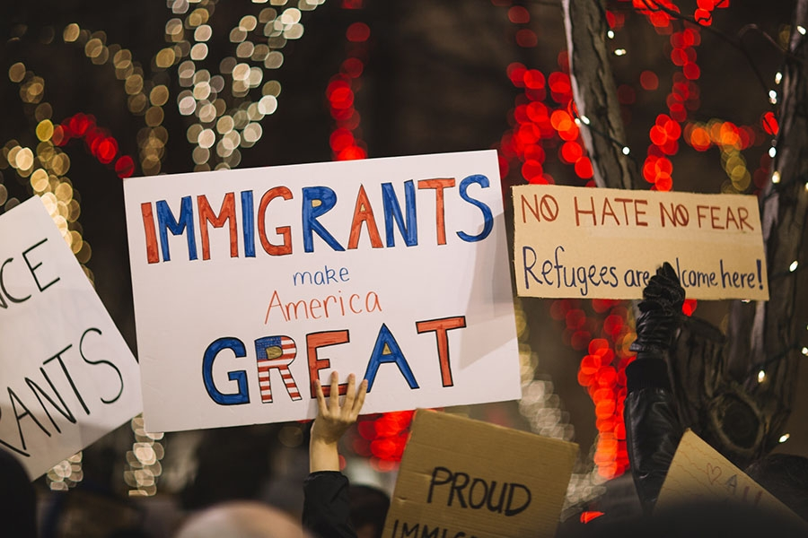 protest signs in support of immigrants and refugees