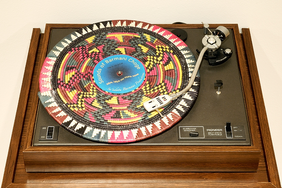 Fatimah Tuggar's artwork: a record player with folk art on the record