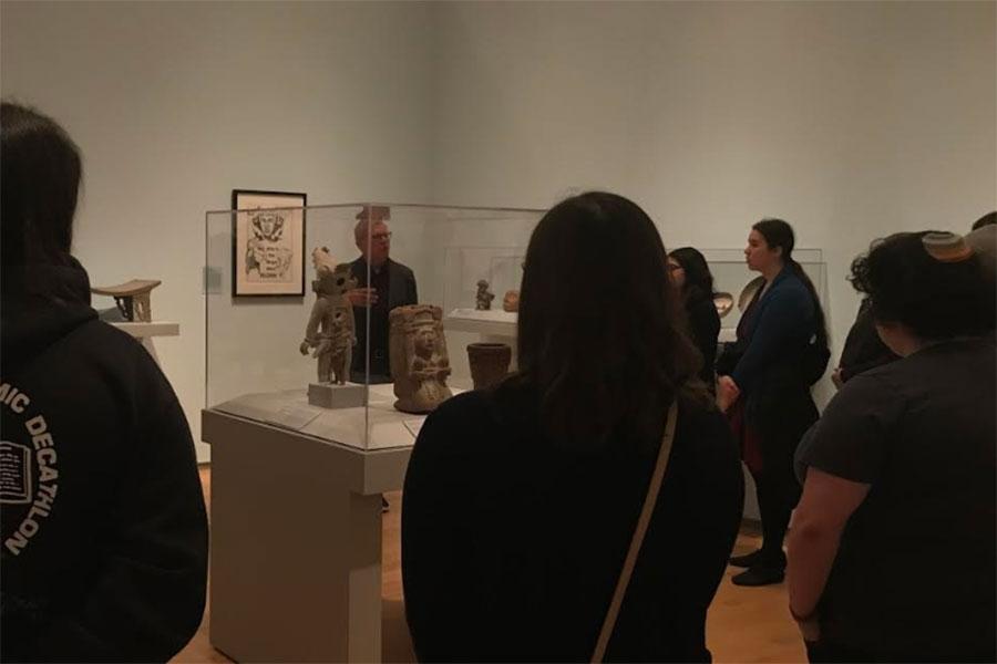 james oles speaking in a gallery
