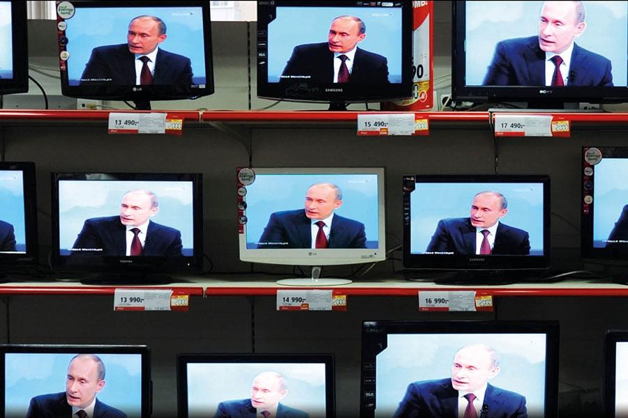 Numerous TV sets displaying images of Vladimir Putin