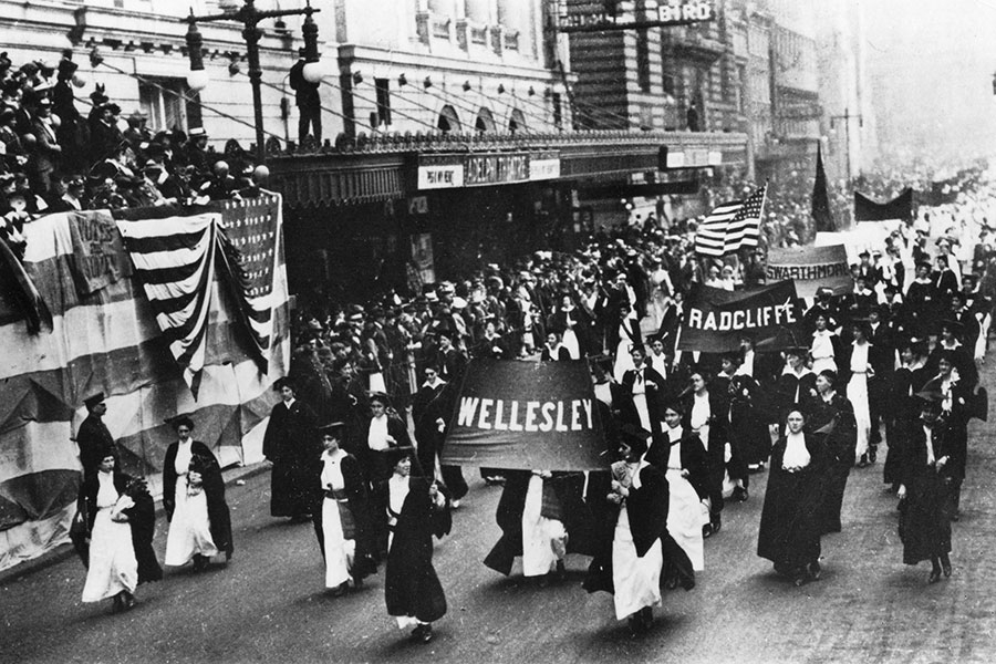 black and white archive photo of Wellesley students marching in a 1915 suffrage parade