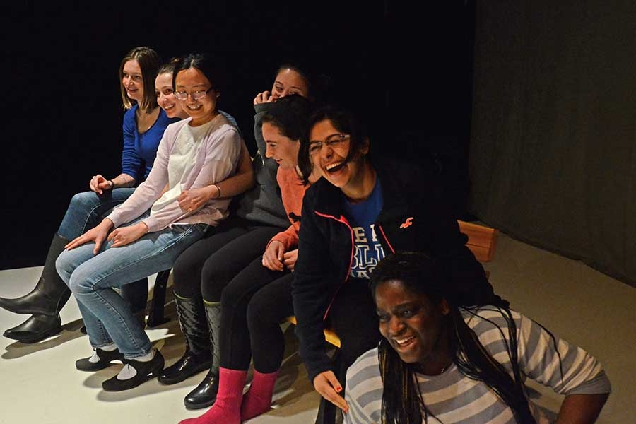 a group of Wellesley theater students smiling and laughing together