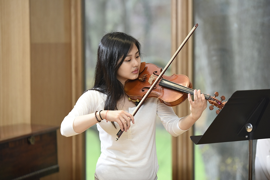 honors music department student playing the violin