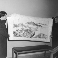 Soong Mayling holding up one of her paintings.