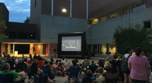 An outdoor film screening on Davis Plaza